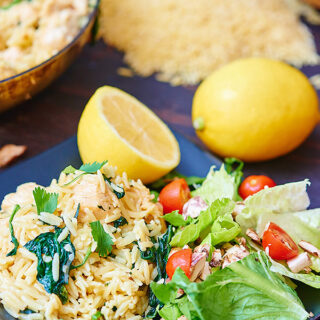 Lemon Garlic Chicken and Orzo Pasta is light, filling, and super yummy! Orzo pasta is mixed with chicken, garlic, spinach, and parmesan cheese! It's then topped with lemon juice. Red pepper flakes gives this dish just a touch of heat. showmetheyummy.com #pasta #orzo #lemon #garlic #chicken #easyrecipe