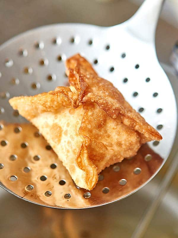 Cheese wontons with honey mustard dipping sauce! Seriously, what's better than that? Crispy fried golden wontons stuffed with gooey, melty cheese and dipped in sweet and tangy honey mustard. Perfection! www.showmetheyummy.com #cheese #wontons #honeymustard #appetizers