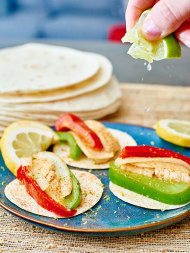 Sizzling, spicy chicken, with crunchy bell peppers, caramelized onions, and rice and refried beans, piled inside a flour or corn tortilla! www.showmetheyummy.com #mexican #tortilla #chicken #fajitas #veggies #dinner #spicy