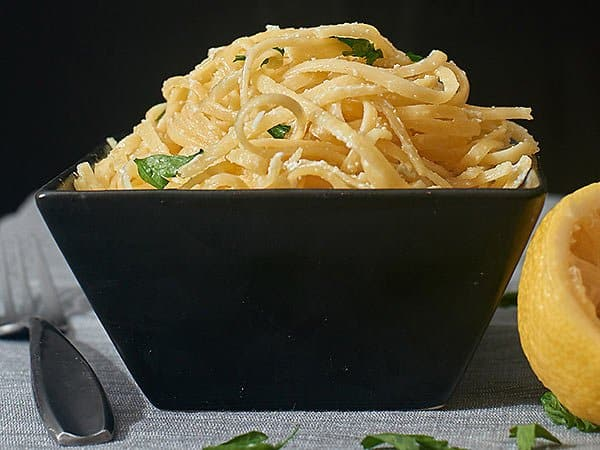 Lightened up greek yogurt lemon pasta chock full of yummy garlic! www.showmetheyummy.com #lightenedup #vegetarian #pasta #lemon #garlic #greekyogurt #healthy #meatlessmonday