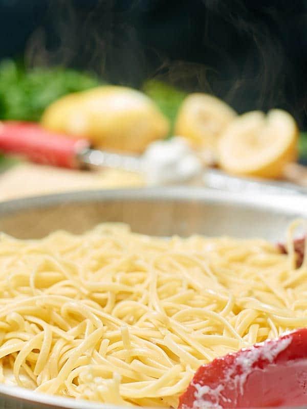Lightened up greek yogurt lemon pasta chock full of yummy garlic! www.showmetheyummy.com #lightenedup #vegetarian #pasta #lemon #garlic #greekyogurt #healthy #meatlessmonday