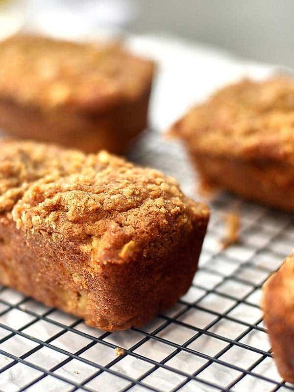 My favorite crumbly, moist, perfectly sweet mini apple cake filled with finely chopped apples, loads of brown sugar, cinnamon, and vanilla! www.showmetheyummy.com #apple #cake #applecake #fall #baking #fallbaking #sugar #brownsugar #dessert #breakfast #glaze