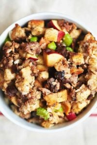 This best ever sausage stuffing is salty from the sausage, crunchy from the bread cubes, sweet and tart from the red delicious apples! Move over turkey, this best ever stuffing is ready to take the main stage! www.showmetheyummy.com #stuffing #thanksgiving #sausage