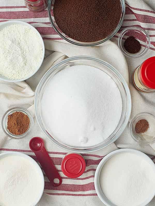 Vanilla chai tea latte ingredients in separate bowls