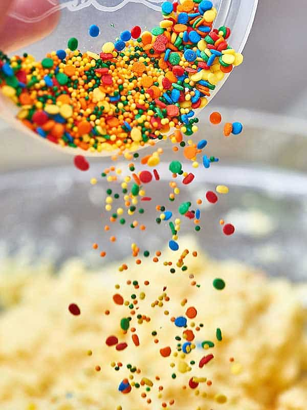 sprinkles being dumped into bowl