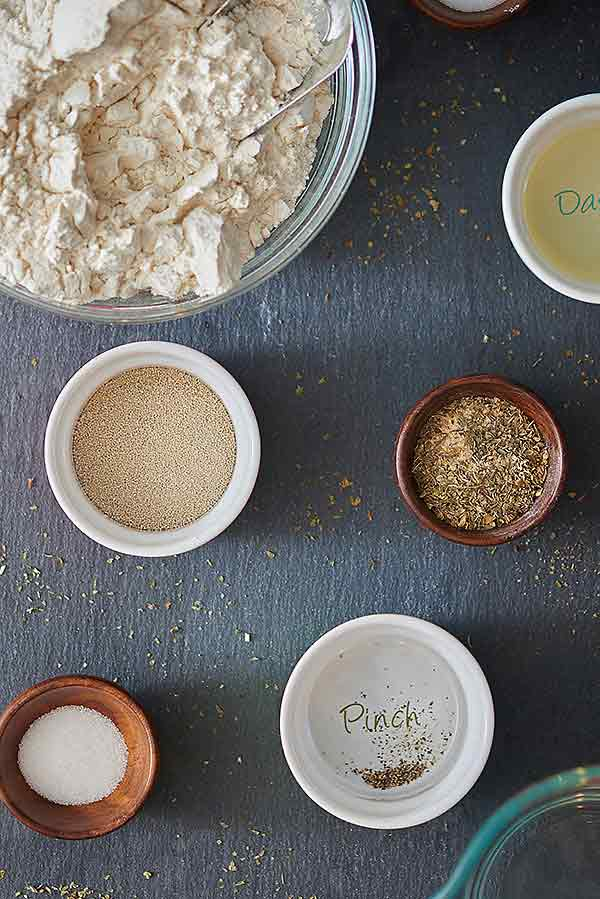 focaccia ingredients in bowls above
