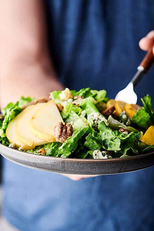 pear, blue cheese, candied pecan salad on a plate