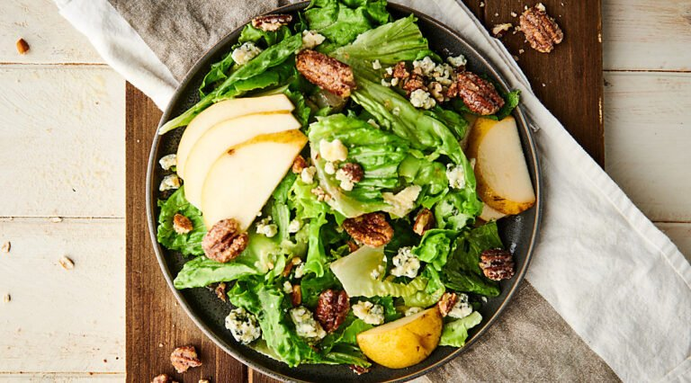 pear, blue cheese, candied pecan salad on a plate horizontal