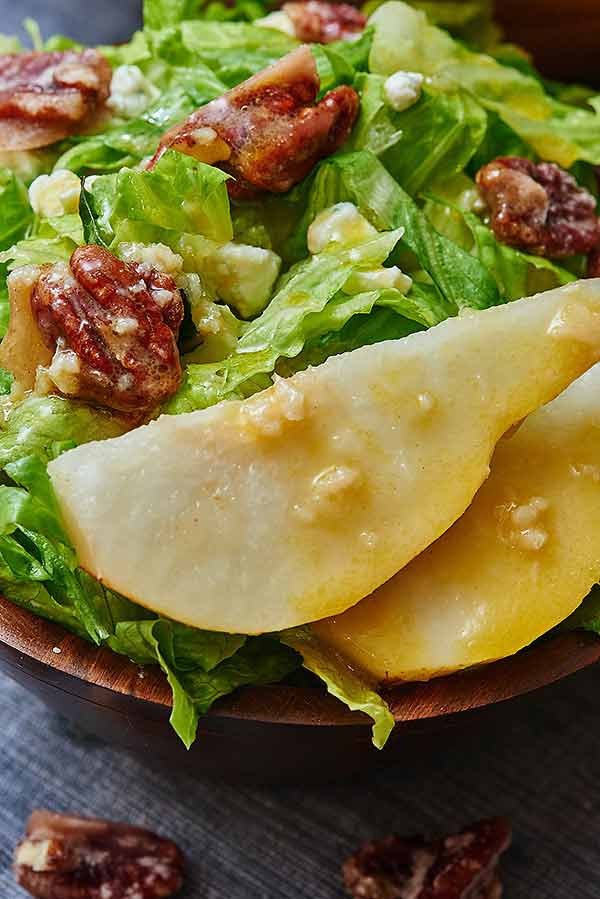 This pear, blue cheese, candied pecan salad has everything you're looking for in a salad. The crisp romaine pairs perfectly with the fresh, juicy pear, creamy blue cheese, sweet and crunchy pecans, and a tangy, sour dressing! There are so many textures and flavors going on in this salad...I mean...what more could you want? www.showmetheyummy.com #salad #healthy #candiedpecans #bluecheese #pear