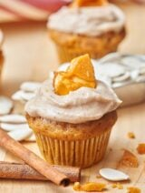 Pumpkin cupcakes w/ cinnamon cream cheese frosting and pumpkin seed brittle. showmetheyummy.com #dessert #pumpkin