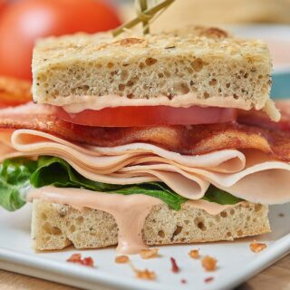 This turkey bacon bravo sandwich is just a little bit chewy from the focaccia, juicy from the tomatoes, fresh from the lettuce, crisp from the bacon, and smoky from the turkey and gouda. And the special sauce? Well, that adds just a little acidity and a spicy kick to round out the whole thing! www.showmetheyummy.com #sandwich #panera #bread #turkeybaconsandwich #lunch