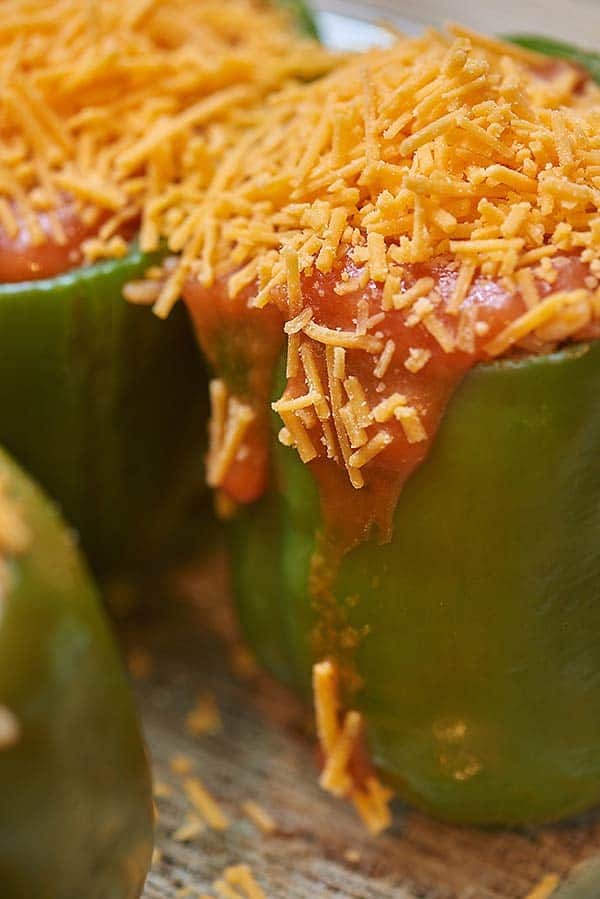 I grew up eating stuffed peppers that were filled with Rice-A-Roni, and although I love that recipe, I'm taking it up a notch by making my own filling of ground beef and rice. It's still simple, still delicious, and yes, it's still extra cheesy (the most important part). Cheese after all is the sixth food group! These cheesy stuffed peppers make a perfect warm, cozy meal, that will make your life a better place... if you like that kinda thing. showmetheyummy.com #stuffedpeppers #cheesystuffedpeppers #rice #groundbeef #easydinnerrecipe