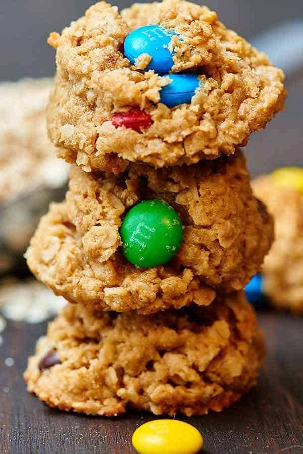 The best monster cookie recipe! I am a cookie snob, so I don't say that lightly! They're thick and a little bit chewy from the oatmeal, extra peanut buttery, filled with melty chocolate chips, with just a bit of crunch from the outside shell of the M&M's and they also happen to be gluten free! showmetheyummy.com #glutenfree #monstercookies #cookies #holiday #baking