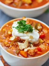 This turkey and vegetable chili filled with ground turkey and tons of veggies will warm you to the bones and leave you feeling full and happy without any guilt! showmetheyummy.com #soup #chili #turkey #healthy #vegetables