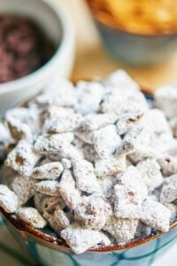 This is the best puppy chow recipe! Why? More chocolate, more peanut butter, more powdered sugar! This childhood classic aka muddy buddies just got better. showmetheyummy.com #puppychow #muddybuddies