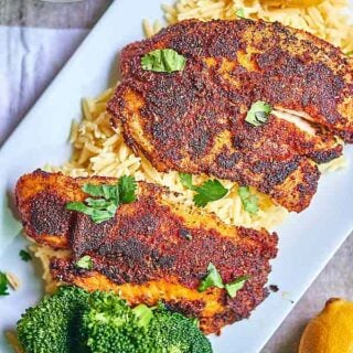 This blackened tilapia recipe is not for the weak! It's spicy, the flavors are bold, and the lemon juice brightens the whole thing up! For those of you who think healthy eating is boring, think again! showmetheyummy.com #fish #tilapia #spicy #spicerub #healthy #lemon