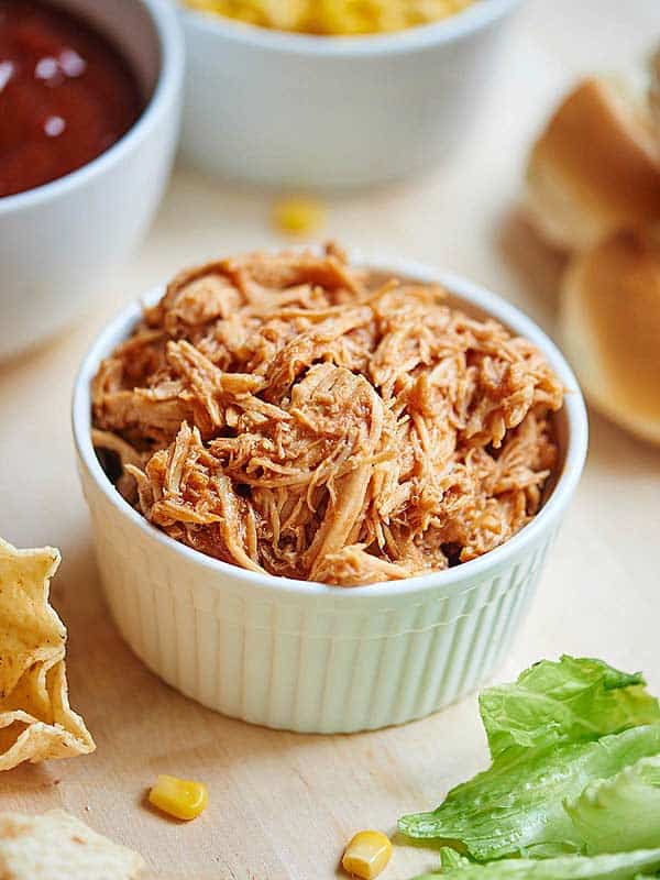I love the idea of serving crockpot BBQ chicken for the Superbowl or any large gathering, because it really is so easy to put together! I also love that it's versatile enough to make three different types of food that will hopefully satisfy all your guests! The classic BBQ chicken sandwich, BBQ nachos, and BBQ chicken salad! showmetheyummy.com #bbq #bbqchickensalad #bbqchickensandwich #nachos #superbowl #bbqchicken