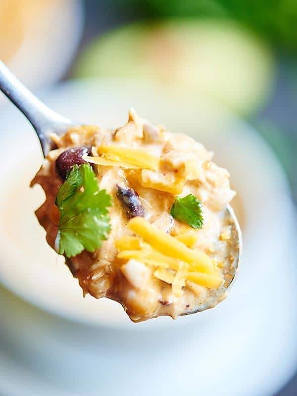 This crockpot jalapeno popper white chicken chili is exactly what you need for the Super Bowl! It's so easy to make, so not messy, perfectly spicy, ridiculously creamy, and filled with chicken, jalapenos, beans, spices, and cream cheese! Can't you just picture enjoying this while watching the game? showmetheyummy.com #crockpot #slowcooker #chicken #chili #jalapenopopper