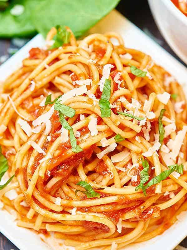 closeup of pile of noodles with homemade spaghetti sauce