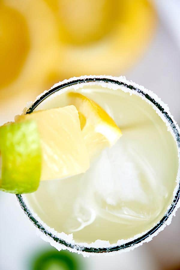 Jalapeno margarita with lemon and lime slices above