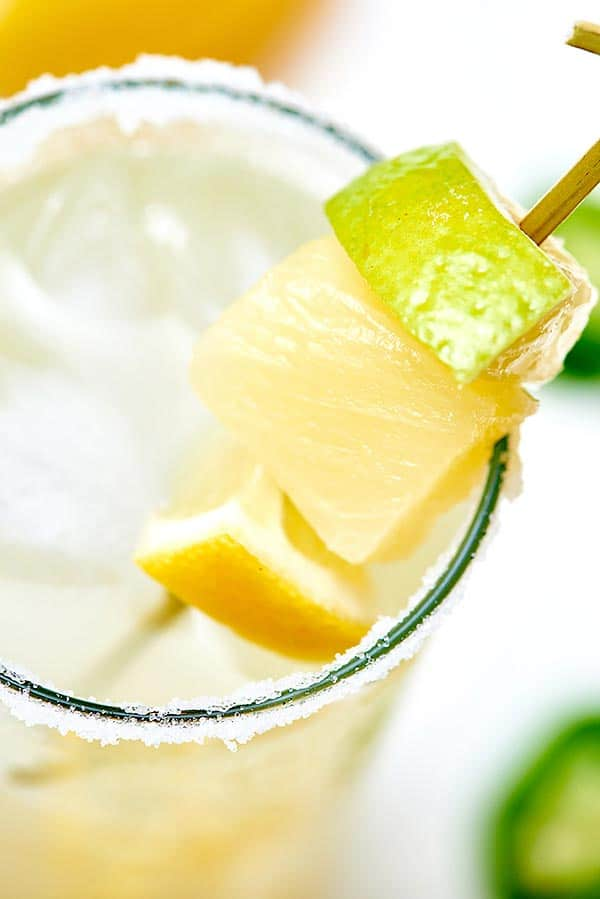 Skewer with lemon, lime, and pineapple in margarita glass