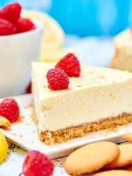 This light greek yogurt cream cheese cheesecake has decadence written all over it, but I love that it's lightened up! I promise you won't miss the full fat cream cheese and heavy sour cream. This cheesecake is light and fluffy, but still rich, has a very subtle lemony flavor and it won't leave you feeling guilty! showmetheyummy.com #light #cheesecake #greekyogurt #creamcheese #lightenedup #dessert
