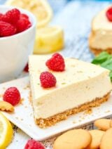 This light greek yogurt cream cheese cheesecake has decadence written all over it, but I love that it's lightened up! I promise you won't miss the full fat cream cheese and heavy sour cream. This cheesecake is light and fluffy, but still rich, has a very subtle lemony flavor and it won't leave you feeling guilty! showmetheyummy.com #cheesecake #greekyogurt