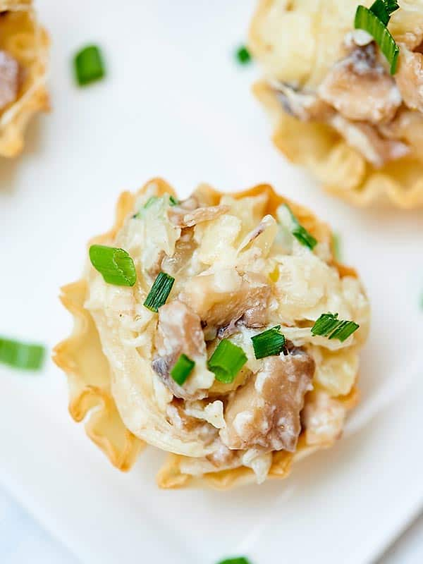 mini caramelized onion, mushroom, and apple tart above