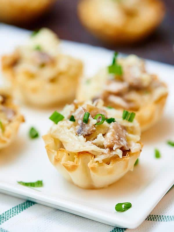 caramelized onion, mushroom, and apple tarts on plate