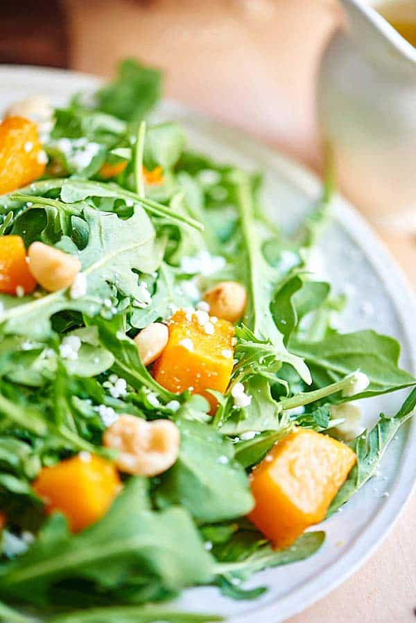 roasted squash arugula salad on plate
