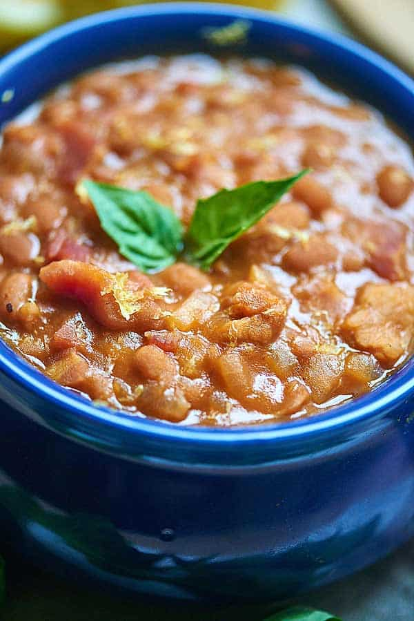 These BBQ Baked Beans are a little sweet, a little smokey, and I just love the texture! Imagine eating these this summer alongside jalapeno cheddar cornbread and a big, juicy, cheesy cheeseburger! showmetheyummy.com #bbq #bakedbeans #grilling #sidedish #bacon