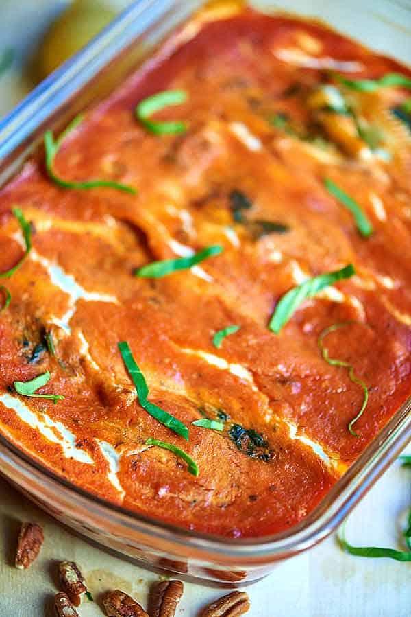 baking dish of cheesy spinach stuffed shells