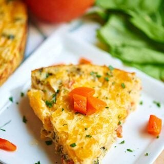 Crustless Goat Cheese Quiche. A great make ahead breakfast that you can just pop in the microwave all week! This quiche is creamy, packs in a ton of veggies, plus it's cheeeeesy and I love the classic combination of goat cheese and roasted red peppers! showmetheyummy.com #quiche #breakfast #glutenfree #vegetarian #goatcheese