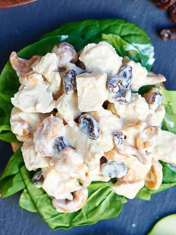 Chicken salad on spinach above