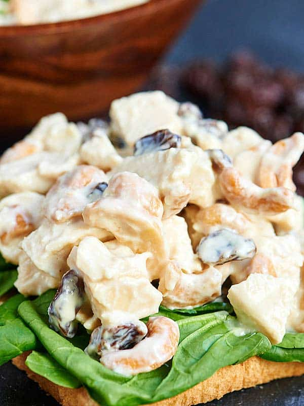 Greek yogurt chicken salad on toast with spinach