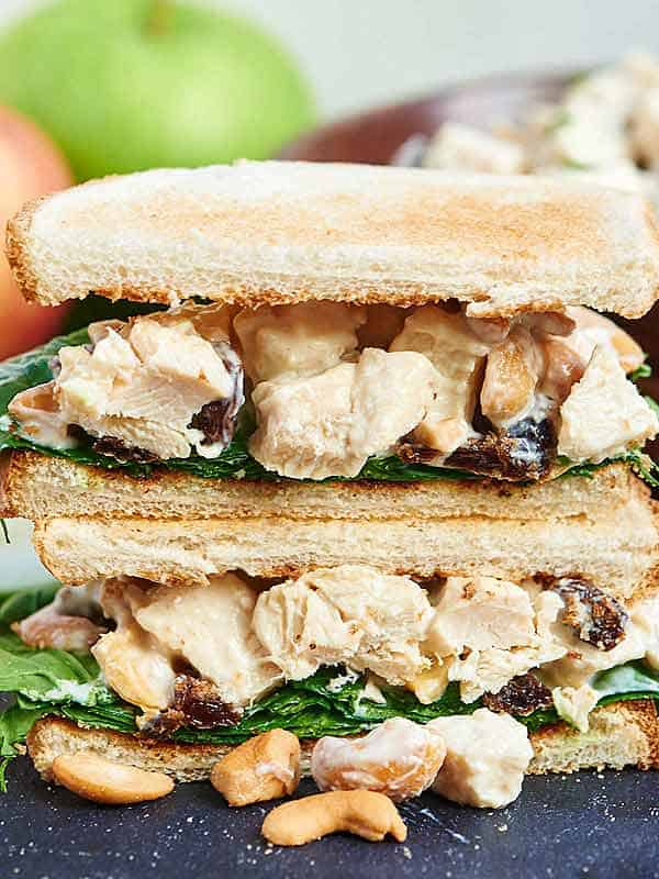 2 halves of greek yogurt chicken salad sandwich stacked