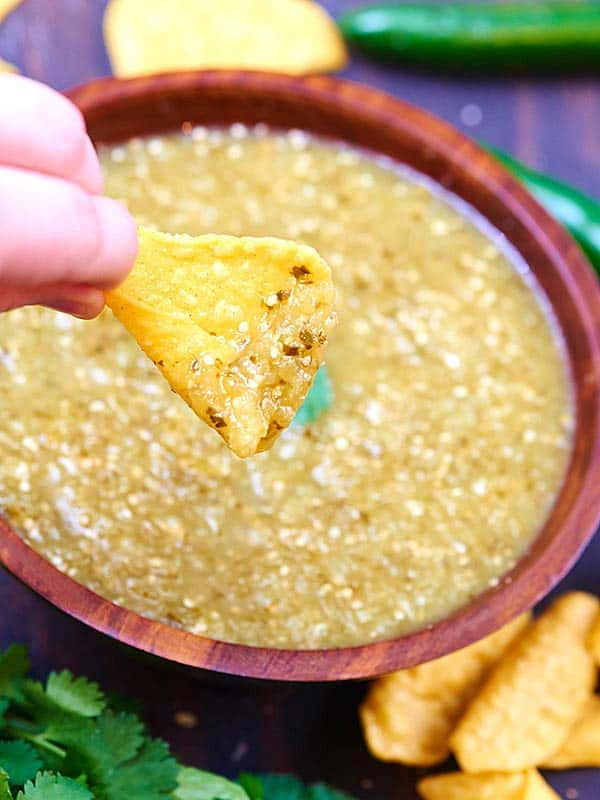 This homemade salsa verde has a whole lot going on! It's got a nice bite from the lime, a touch spicy from the serrano, and the cumin adds such a subtle but really great depth of flavor! showmetheyummy.com #salsa #mexican #vegetarian #vegan