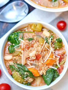 This quinoa minestrone is so healthy, full of flavor, and loaded with pancetta, vegetables, quinoa, pesto, and white wine! showmetheyummy.com #quinoa #minestrone #quinoaminestrone #vegetables #glutenfree #pesto #wine