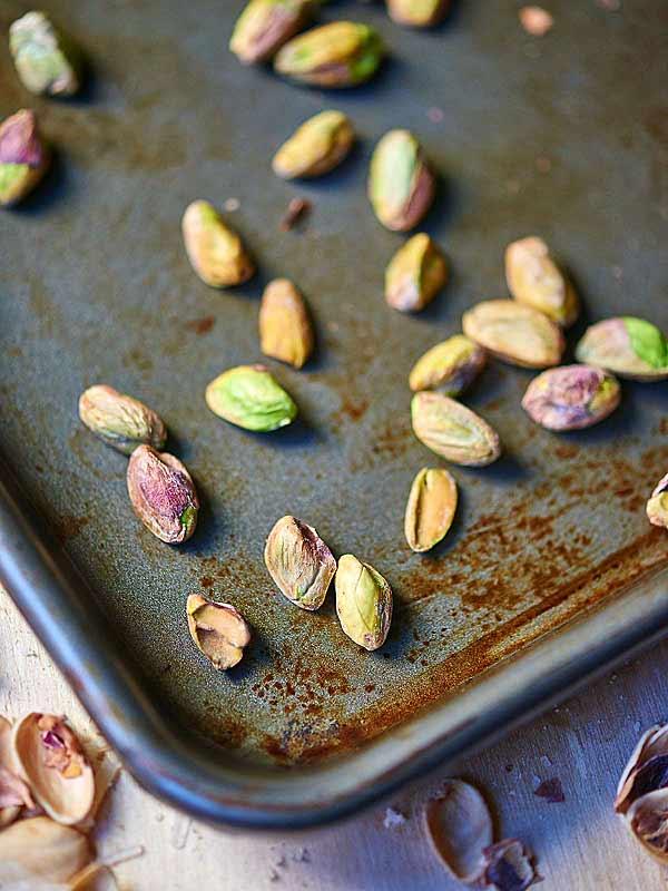 roasted pistachios on baking sheet