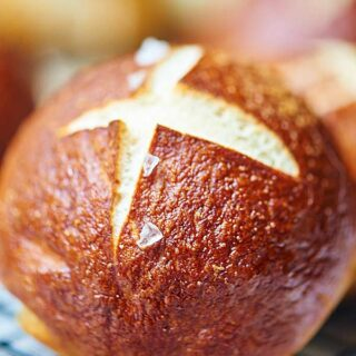 These soft pretzel rolls are great on their own...chewy, buttery, fluffy. If you're looking to make these into a meal, however, these make amazing sandwiches and an even better panini! Ham, cheddar, dijon, a little mayo, a slice of tomato, and fresh romaine lettuce…customize it to make your new favorite sandwich...the possibilities are endless! Whatever you do, I highly recommend putting that baby on a griddle to make this panini style! showmetheyummy.com #pretzel #rolls #sandwiches #vegetarian #pretzelrolls #softpretzels #baking