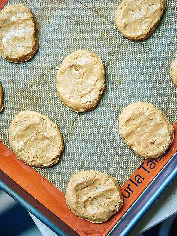 Peanut butter patties on baking sheet