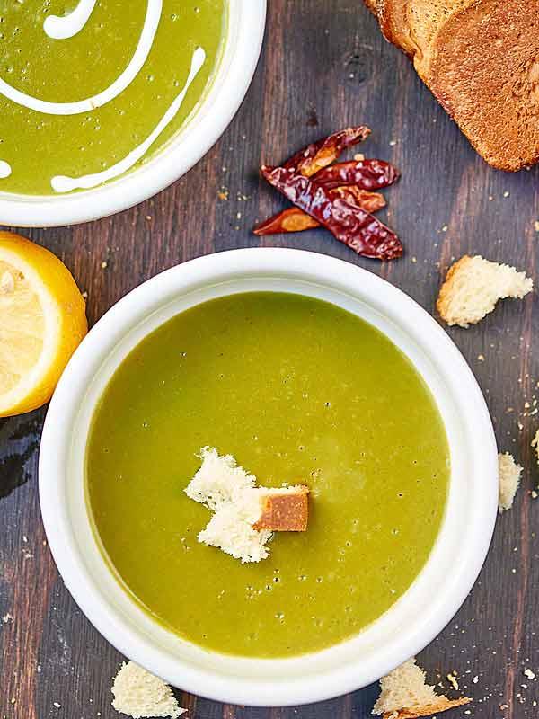 Bowl of creamy vegan spinach potato soup above