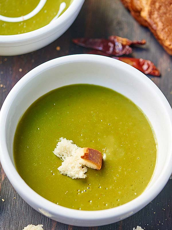 This creamy vegan spinach potato soup is quick, easy, nutrient dense, beautifully green, and truly delicious! All you need is spinach, potatoes, broth, lemon juice, and a few spices and you're good to go! showmetheyummy.com #healthy #vegan #glutenfree #vegetarian #soup #spinach #potato #green