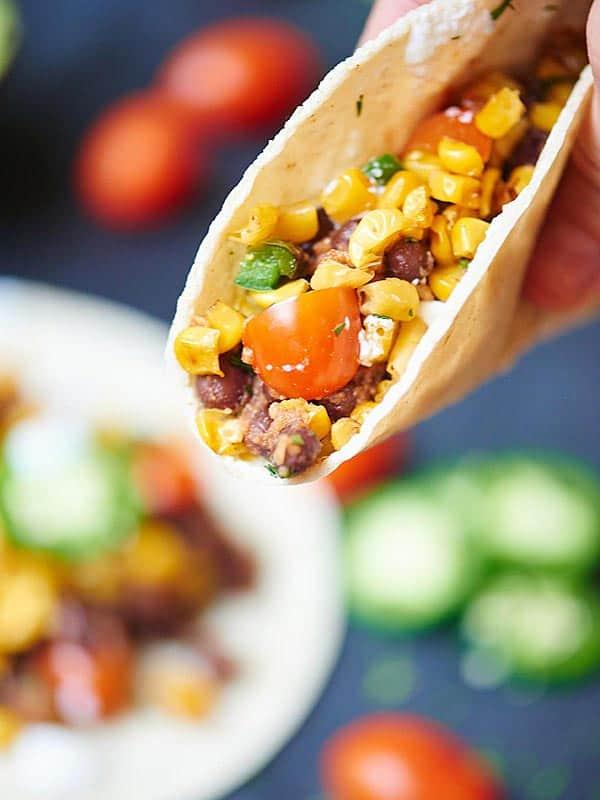 Vegan black bean and corn taco held