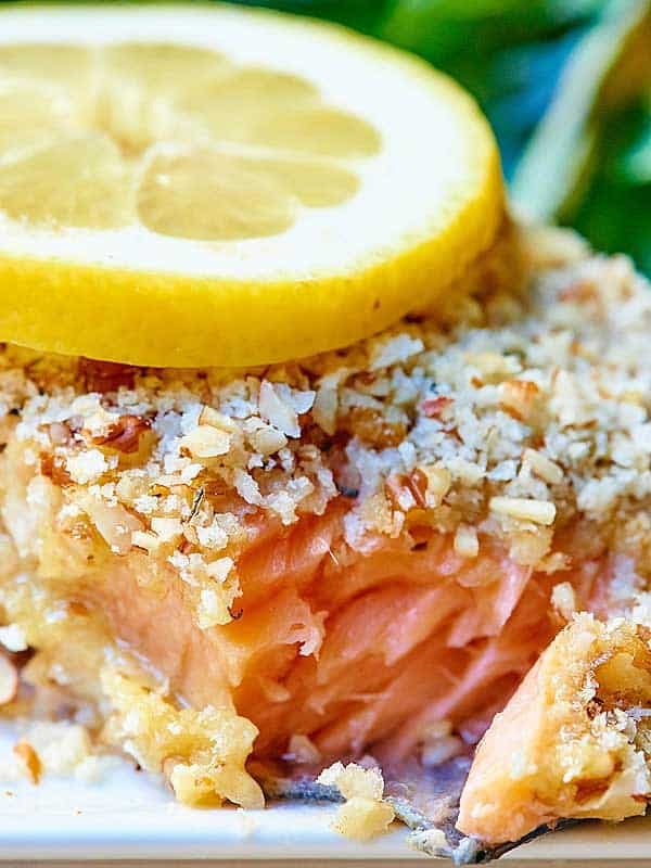 "This pecan crusted honey mustard salmon is seriously delicious. The combination of the hearty, yet flakey salmon with the sweet and tangy honey mustard and the toasted and crunchy pecan crust makes for one heckofa dish. It's a perfect, easy weeknight meal that will surely ""wow"" whoever you serve it to. showmetheyummy.com #healthy #salmon #pecans #honeymustard #seafood"