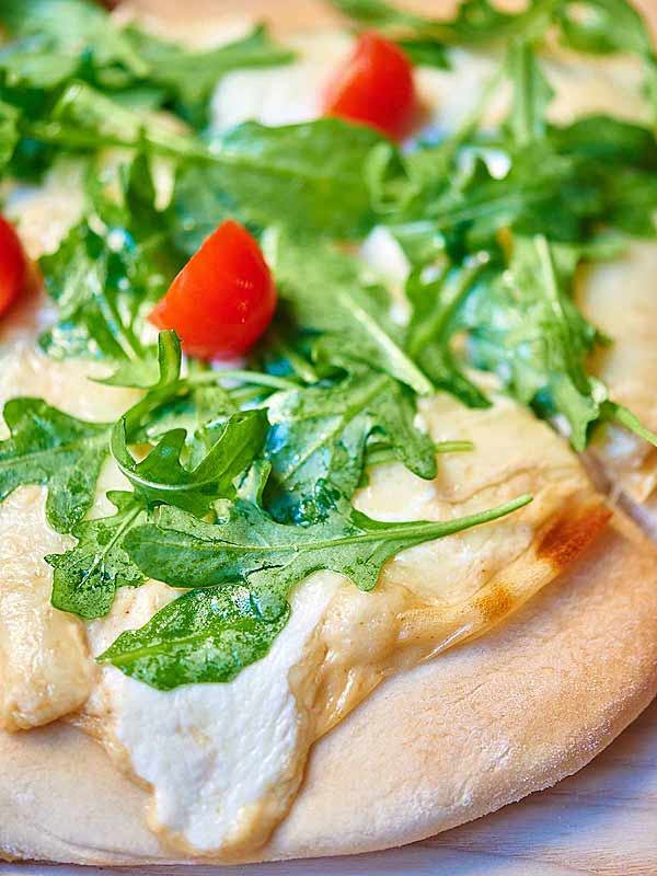 garlic white cheese pizza with arugula closeup
