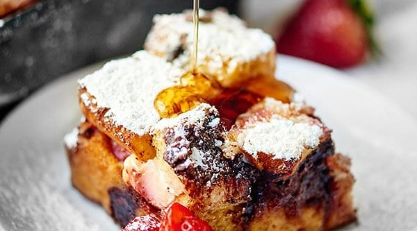 Strawberry Nutella Cream Cheese French Toast Casserole. Thick slices of brioche are smothered in nutella and layered with strawberries and cream cheese. The whole casserole is soaked overnight in a cream, sugar, cinnamon mixture and baked until hot and french toasty! showmetheyummy.com #nutella #strawberry #frenchtoast #casserole #breakfast #creamcheese