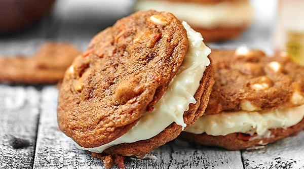 Carrot Cake Cookies with Toasted Coconut Cream Cheese Frosting. A sweet treat for Easter day! showmetheyummy.com #carrotcake #easter #creamcheese #frosting #coconut #cookies #spring