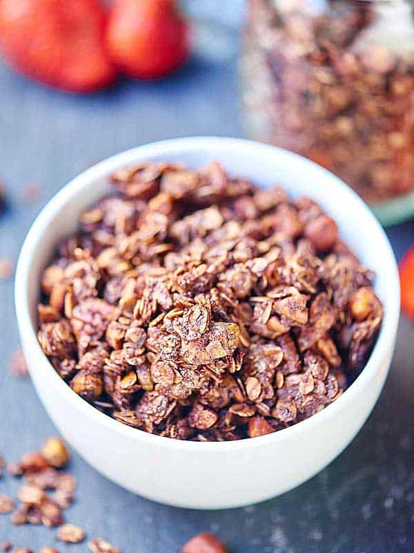 Double Chocolate Chip Granola. Healthy enough for breakfast, but indulgent enough for dessert! showmetheyummy.com #nuts #granola #breakfast #dessert #chocolate #coconutoil #honey #maplesyrup #glutenfree #vegetarian