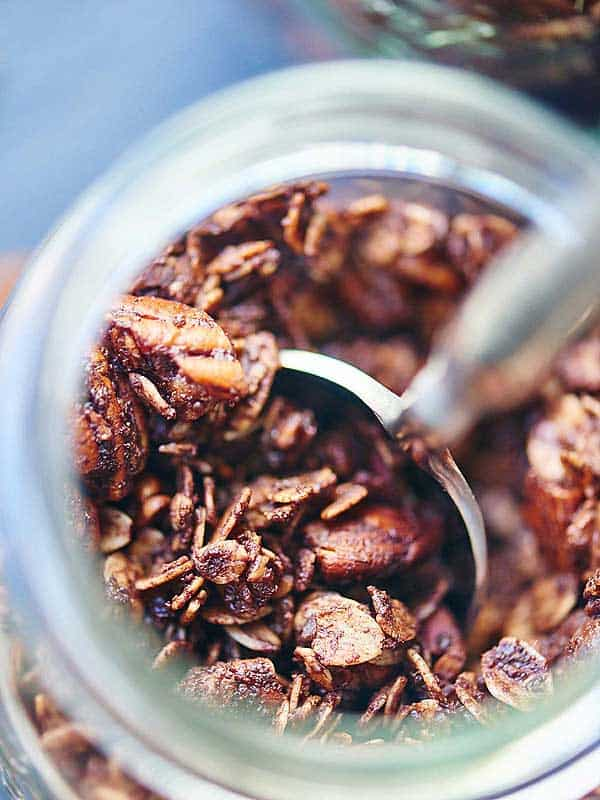 jar of double chocolate chip granola above with spoon